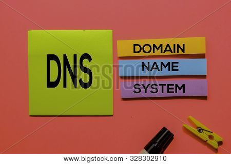 Dns - Domain Name System Acronym Write On Sticky Notes Isolated On Pink Background.