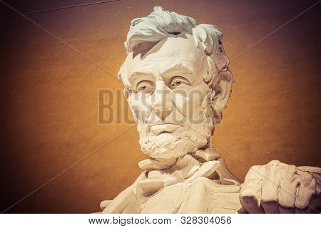 Night Time Image Of The Statue Of Abraham Lincoln In The Lincoln Memorial In Washington Dc.