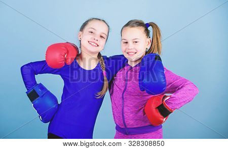 Confident Teens. Female Boxers. Boxing Provide Strict Discipline. Competitors On Ring And Friends In