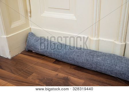 Draft Excluder Under Door Blocking Cold Air From Traveling Around