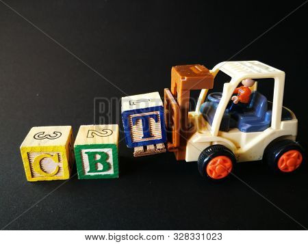 Toy forklift with CBT wooden block