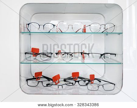 Shelving With Glass Shelves With Glasses And Frames In The Optics Store To Improve Vision And Correc