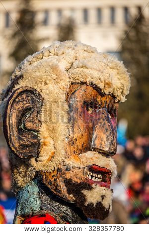 Mummers perform rituals to scare evil spirits at Surva festival at Pernik in Bulgaria. The people with the masks are called Kuker (kukeri). Wood mask with wool beard.