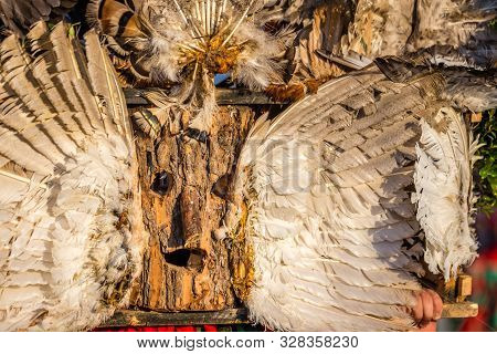 Mummers perform rituals to scare evil spirits at Surva festival at Pernik in Bulgaria. The people with the masks are called Kuker (kukeri). Wood mask and feathers.