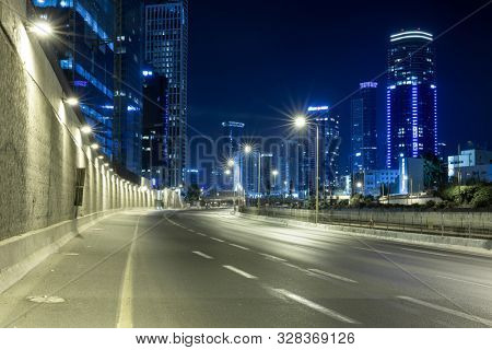 Empty Freeway At Night And Tel Aviv Skyline in Background