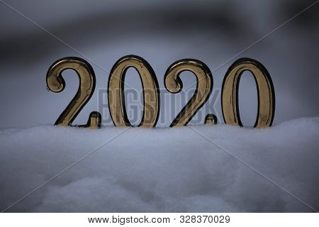 Merry Christmas And Happy New Year 2020. Inscription In Golden Numbers 2020, Standing In The Snow, S