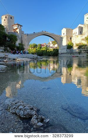 Reflections Of The Old Bridge (stari Most), Viewed From The Banks Of The Neretva River, Mostar, Bosn