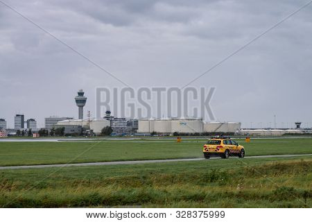 Amsterdam, Schiphol Airport, The Netherlands, 09/20/2019, Yellow Airport Authorities Cars At Schipho