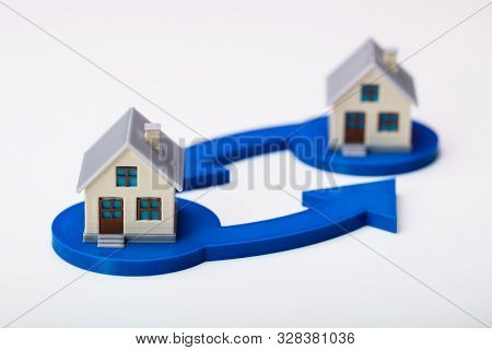 Two Houses And Arrows In House Swapping Concept