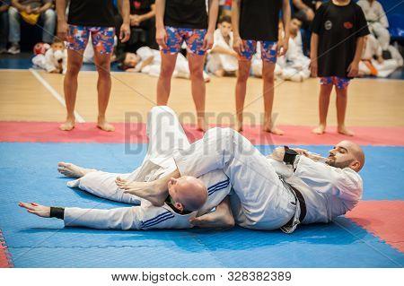 Bjj Martial Art Instructor Demonstrate Brazilian Jiu-jitsu Ground Fighting Techniques