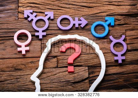 Question Mark Inside Persons Head Outline And Multiple Gender Signs Around