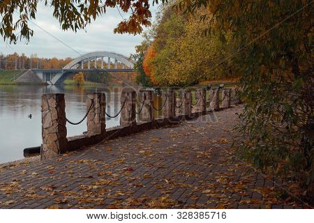 View Of The Autumn Park And The Railway Bridge Over The Moscow Canal