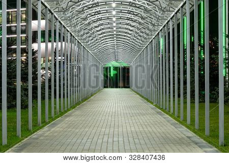 Futuristic Pedestrian Overpass Tunnel With Bright Lighting, Receding Into The Distance At Night. Mod