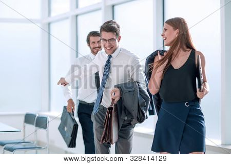 young employees leaving the office at the end of the working day
