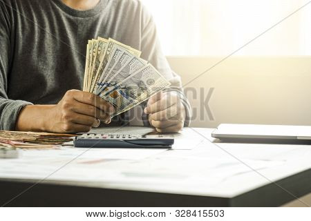 Businessman Holding And Give Us Dollar Banknoted.us Dollar Is Main And Popular Currency Of Exchange