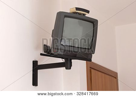Old Small Square Crt Tv At Wall Holder