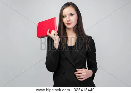 Young Brunette Girl In Business Suit Holding Red Notepad, White Background, Dark Straight Hair,