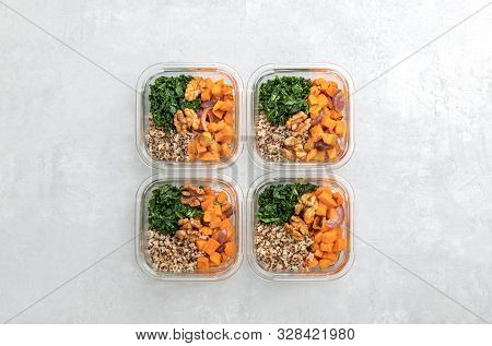 Sauteed Kale, Quinoa And Roasted Sweet Potato Lunch Box Bowl, View From Above