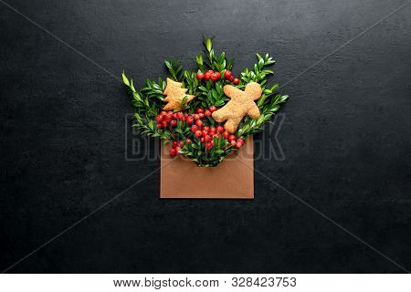 Christmas Greeting Card Minimalist Concept, Open Envelope With Holiday Natural Botany Decorations,