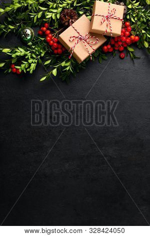 Noel Or Christmas Dark Background With Gift Boxes And Natural Winter Holidays Traditional Botany Dec