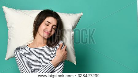 Sleeping Woman Of The 20s On Pillow In Home Clothes, Happily Relaxing At Home And Yawning Because Of