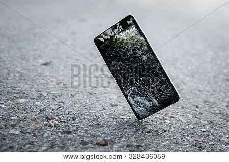 Mobile Phone Falling And Crashes On Asphalt, Broken Smartphone Flying Down To Ground. Smashed, Destr