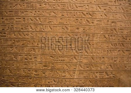 Ancient Egyptian Hieroglyphs On The Wall In Cairo Museum