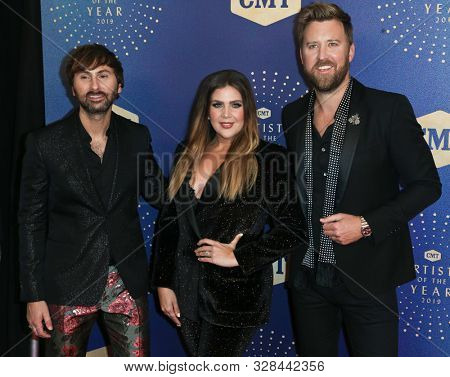 NASHVILLE, TEN-OCT 16: (L-R) Dave Haywood, Hilary Scott & Charles Kelley of Lady Antebellum attend the 2019 CMT Artists of the Year at Schermerhorn Symphony Center on October 16, 2019 in Nashville.