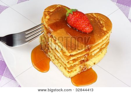 Heart-shaped Pancakes With Syrup And Strawberry