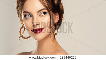 Beautiful Model Girl With Burgundy Or Wine Color Lips . Fashion Makeup And Cosmetics . Jewelry, Earr