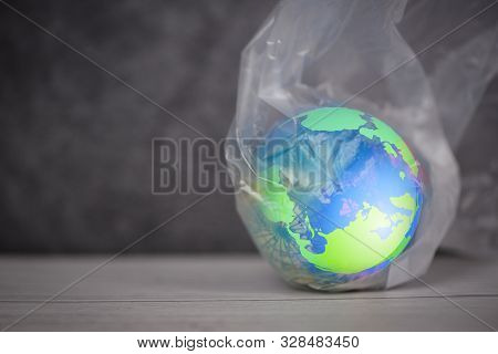 Plastic World Or World Environment Day Concept / The Planet Earth In A Plastic Bag Ban Say No Plasti