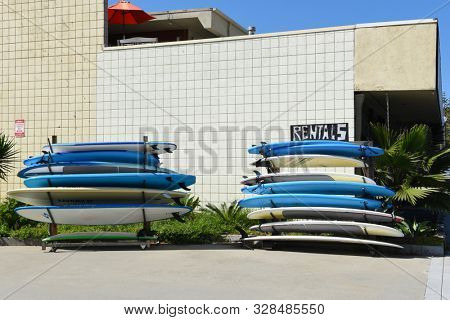 DANA POINT, CALIFORNIA - 18 OCT 2019: Display of rental surfboards outside the  Infinity Surfboards shop.