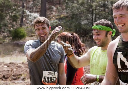 POCONO MANOR, PA - APR 28: Entrants give high-5s at Tough Mudder event on April 28, 2012 in Pocono Manor, PA. Designed by British Special Forces, the event supports the Wounded Warrior Project.