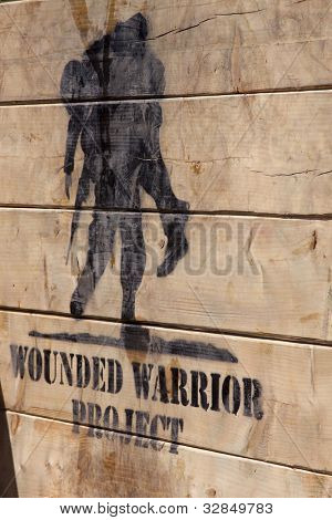 POCONO MANOR, PA - APR 29: The Wounded Warrior Project logo painted on Berlin Walls obstacle at Tough Mudder on April 29, 2012 in Pocono Manor, PA.  The course is designed by British Special Forces.