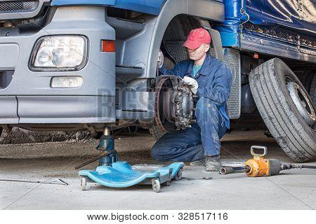 Mechanic Repair Truck Is On The Jack