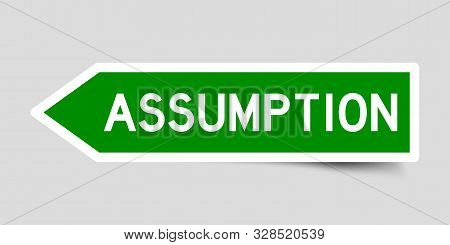Green Color Arrow Sticker With Word Assumption On Gray Background