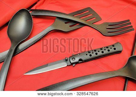 Folding Knife Stainless Steel Sharp Blade Red Background Black Flatware Fork Spoon