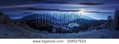 Panorama Of A Mountain Ridge At Night.  Beautiful Autumn Landscape Of Carpathians In Full Moon Light