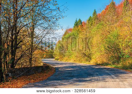 Old Asphalt Road In Mountains. Path Along The Forest On Hill. Trees In Fall Colors. Distant Ridge In