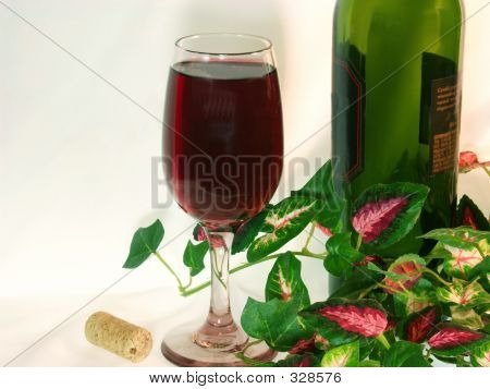 Wine Glass  With Part Of Bottle On White Background