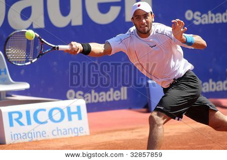 BARCELONA - APRIL, 26: Colombian tennis player Robert Farah in action during his match against Rafael Nadal of Barcelona tennis tournament Conde de Godo on April 26, 2012 in Barcelona