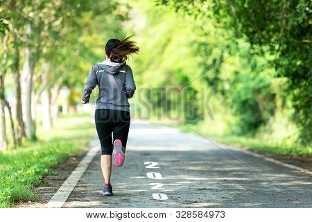 The Start Into The New Year 2020. Start Up Of Runner Woman Running On Nature Race Track Go To Goal O