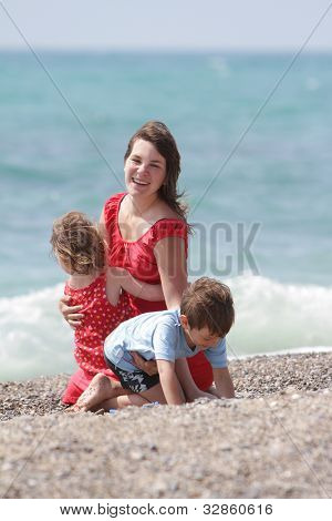 mother and two children on sea background