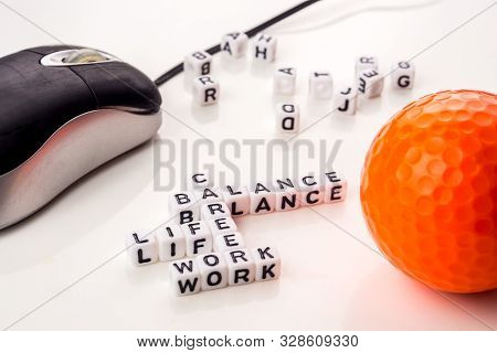 Little White Dices With Black Letters Forming A Crossword With The Theme Work Life Balance As Equili