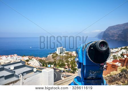 Monocular Telescope Pointing At Los Gigantes Town, Tenerife.