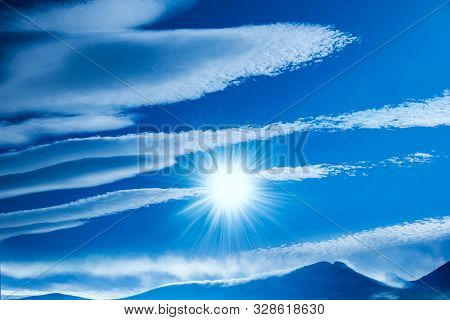 High Mountain Peak Covered With Snow In Winter . Snow Mountain And Blue Sky . Cloud Landscape  . . R