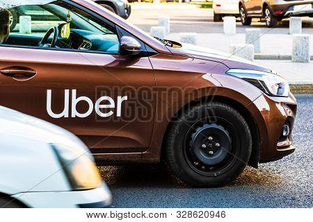 Uber Car In Traffic, Modern City Taxi Service In Bucharest, Romania, 2019