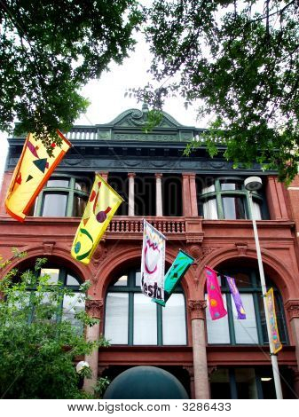 Old-Fashioned Building And Fiesta Flags