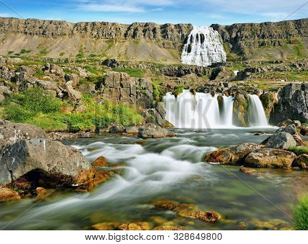 Waterfall In Iceland. Amazing Landscape Of Volcanic Island. Natural Miracle.