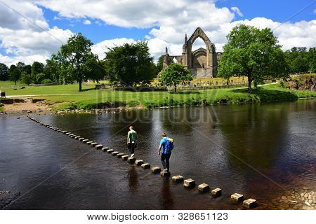 Bolton Abbey In The Yorkshire Dales National Park, With Stepping Stones Across The River Wharfe.